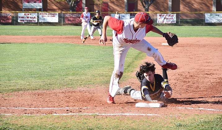 Mingus junior Andrew Kulis tries to tag out a Sabercat at first during the Marauder's 11-10 win over Saguaro on Friday afternoon at home.  Kulis had 4 RBIs in Mingus' wins against Cactus and Coconino earlier in the week. (VVN/James Kelley)