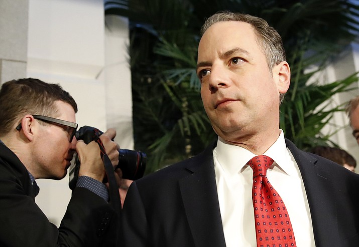 White House Chief of Staff Reince Priebus, right, departs after a Republican caucus meeting on Capitol Hill, Thursday, March 23, in Washington.