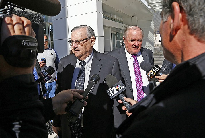In this Jan. 25 file photo, former Maricopa County Sheriff Joe Arpaio, left, and his attorney Mel McDonald leave U.S. District Court in Phoenix.