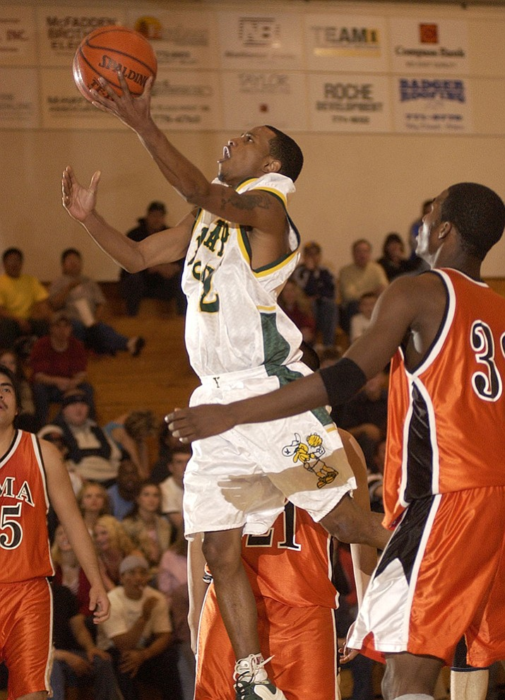 Elton Simpson goes for a basket during a game for the Yavapai College Roughriders, during the 2002-03 season.