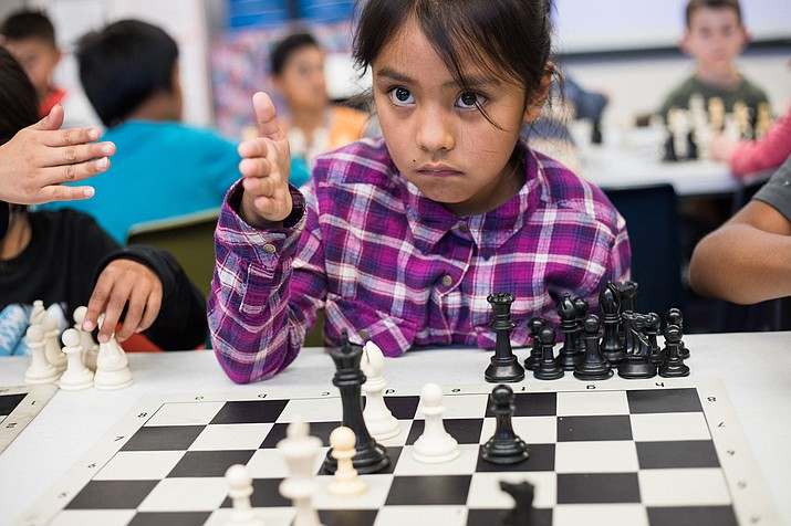 A Killip Elementary student concentrates on what the next move should be during a practice session at Killip March 21. Students practice chess skills and strategy to prepare to compete at the Super Nationals in Nashville, Tennessee. To qualify for the national competition, students go through several rounds of ranking and practice four days a week to learn how to compete against one another and other competitors. Photos/Ryan Williams Photography