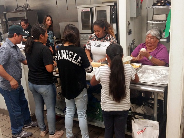 Meme Jetter-Nanacasia helps prepare fry bread for the Navajo taco fundraiser March 22.
