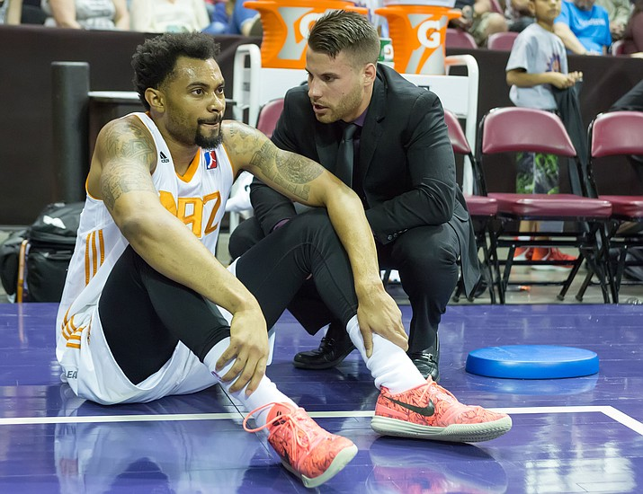 Northern Arizona Suns head athletic trainer Jonathan Mac tends to forward Xavier Silas in a game against the Sioux Falls Skyforce on March 12 in Prescott Valley. March is National Athletic Training Month and Mac is a big reason why the Suns had a successful first season in Prescott Valley. (NAZ Suns/Courtesy)