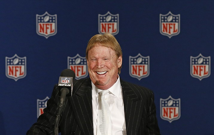 Oakland Raiders owner Mark Davis smiles as he steps up to the podium during a news conference after NFL football owners approved the move of the Raiders to Las Vegas in a 31-1 vote at the NFL meetings Monday, March 27, in Phoenix. (Ross D. Franklin/AP)