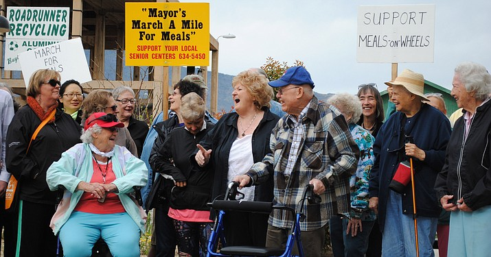 "Elaine Bremner, Executive Director of the Verde Valley Senior Center in Cottonwood, along with other enthusiastic members of the community, pause for a photo opportunity before embarking on the ninth annual ""March for Meals"" Saturday morning. (VVN/Jennifer Kucich)"