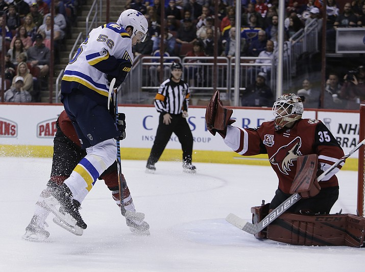 Arizona Coyotes goalie Louis Domingue (35) makes the save on St. Louis Blues left wing Magnus Paajarvi (56) in the first period Wednesday, March 29, in Glendale. (Rick Scuteri/AP)