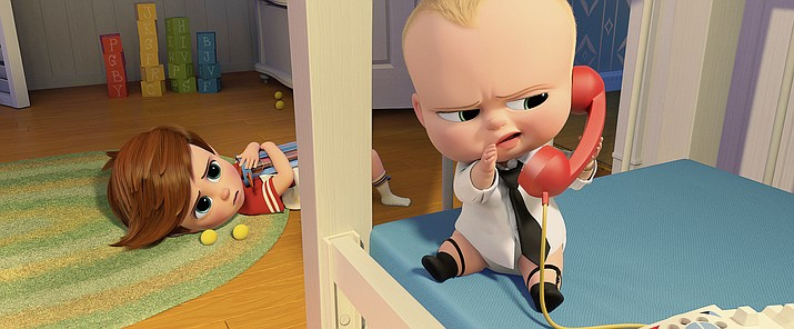 "This image released by DreamWorks Animation shows characters Tim, voiced by Miles Bakshi, and Boss Baby, voiced by Alec Baldwin in a scene from the animated film, ""The Boss Baby."""