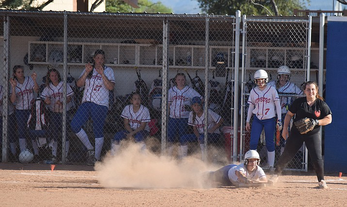 Camp Verde freshman Jade Oium slides into third base during the Lady Cowboys' 17-6 win over Tonopah Valley. Camp Verde has their last two games by a combined 31 runs. (VVN/James Kelley)