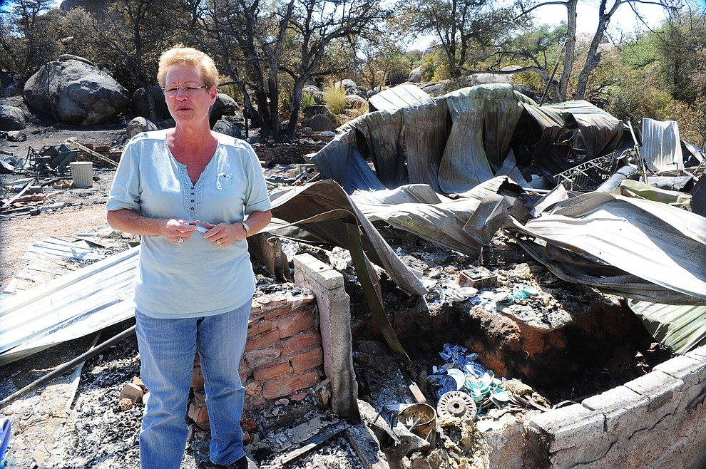 Yarnell - July 10, 2013.Les Stukenberg/The Daily Courier.Donna Holloway talks about the dishes her mother inlaw had saved for years but that burned in their home during the Yarnell Hill fire. Holloway was emphatic though that her thoughts are with the families of the 19 Granite Mountain Hotshots who died trying to stop the fire.
