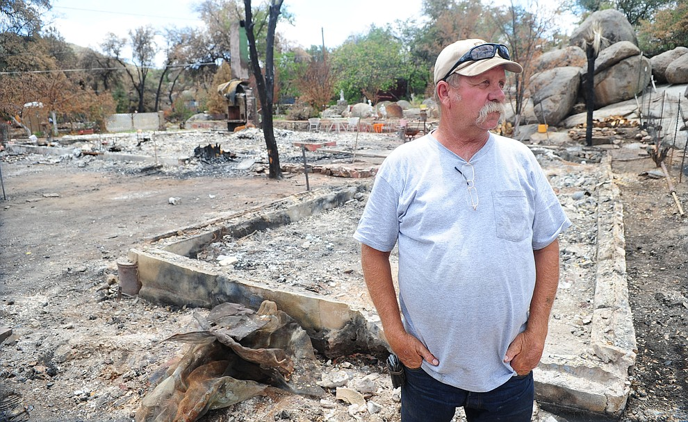 Yarnell, Ariz. - July 23, 2013.Les Stukenberg/The Daily Courier.Steve Keehner looks around some of his neighbor's homes that burned during the Yarnell Hill Fire. Keehner also lost his home but he and his wofe were able to escape with clothes and some important personal possessions.