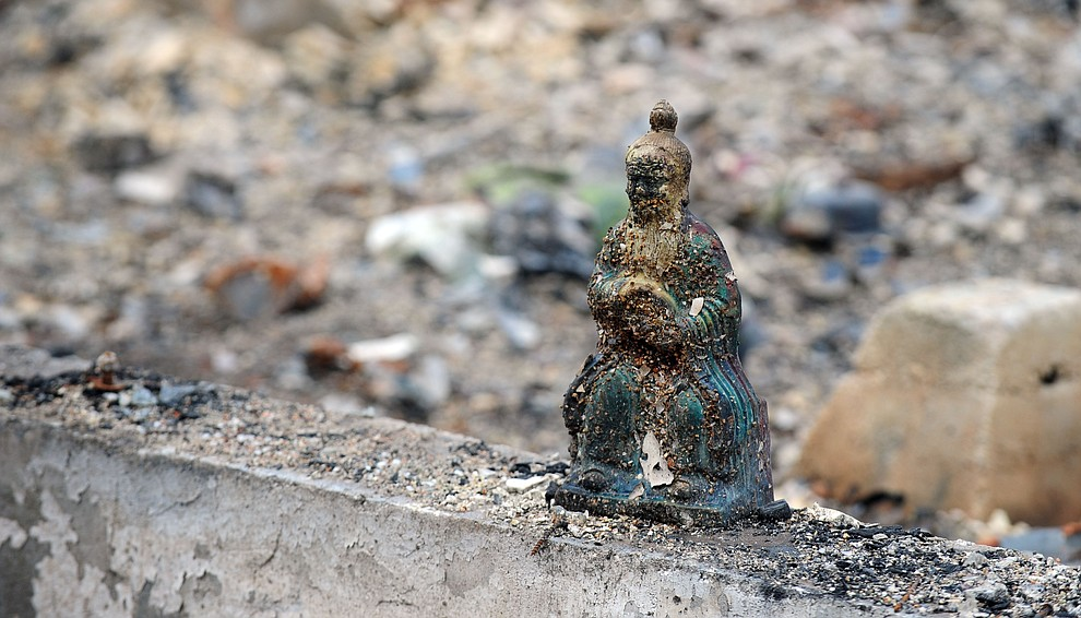 Yarnell, Ariz. - July 23, 2013.Les Stukenberg/The Daily Courier.A small statue sits on the footing of a home that burned in the Yarnell Hill Fire on June 30.