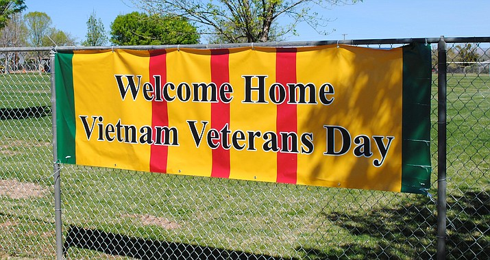 A banner for the sixth annual Verde Valley Welcome Home Vietnam Veterans Day, planned for April 1, hangs at the Cottonwood Kids Park. (VVN/Jennifer Kucich)