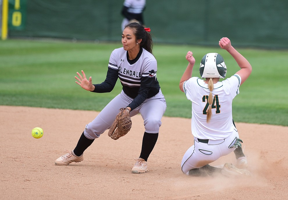 Yavapai College's Mikayla Newham steals second as the Lady Roughrider take on the Glendale Community College Lady Gauchos in the first game of doubleheader Friday, March 31 in Prescott. (Les Stukenberg/The Daily Courier)