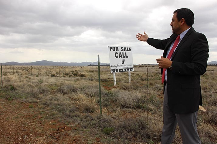 Mike Paredes, Director of the Prescott Valley Economic Development Foundation, stands on the outskirts of available commercially zoned land within Prescott Valley's industrial park.