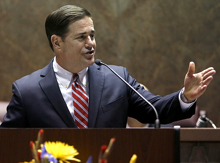 Republican Gov. Doug Ducey signed legislation Friday toughening and expanding an existing abortion law. The Republican-controlled Arizona Legislature passed the bill as the latest action in its yearslong string of anti-abortion measures.