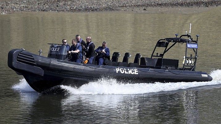 Police patrol the River Thames prior to the annual university Oxford-Cambridge boat race along the river , London, Sunday April 2, 2017. Police have said the annual event will go ahead after a World War II era bomb was safely removed from the shallows of the river near to the start of the race at Putney Bridge in southwest London.