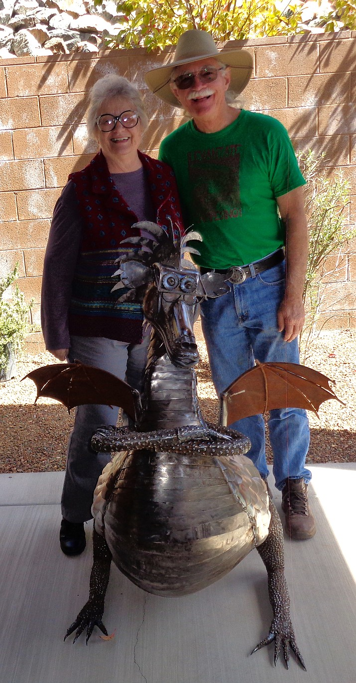 "Jean Lutz and Rick Hartner pose with that ""something special"" dragon."