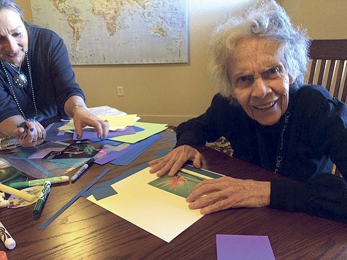 Prescott Meals on Wheels Creative Aging program participant Silvia Herrera, 84, working with visual artist Juanita Hull-Carlson on making a mandala.