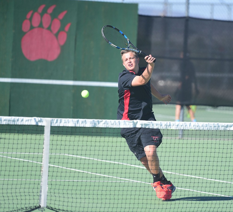 Bradshaw Mountain's Dawson Turner hits a return shot as the Bears take on Lee Wiiliams in boys tennis Tuesday afternoon in Prescott Valley. (Les Stukenberg/The Daily Courier)