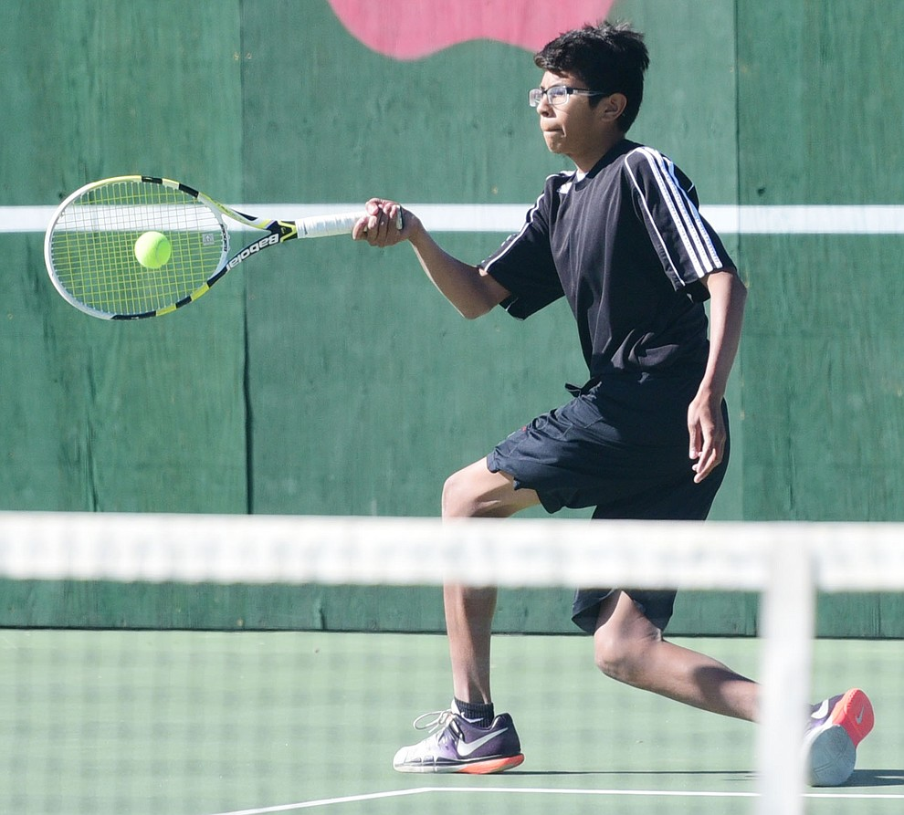 Bradshaw Mountain's Ed Ramos hits a return shot as the Bears take on Lee Wiiliams in boys tennis Tuesday afternoon in Prescott Valley. (Les Stukenberg/The Daily Courier)