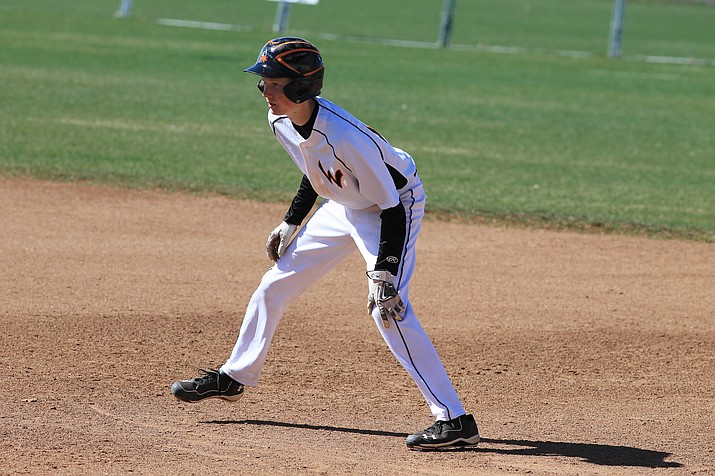 Payce Mortensen looks to run to second during a game with Mayer.