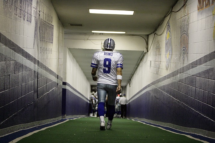 Dallas Cowboys quarterback Tony Romo walks down the tunnel to the playing field at Texas Stadium before an NFL football game, Sunday, Dec. 14, 2008, in Irving, Texas. The Cowboys will close out the season with the last game scheduled for the stadium on Saturday, Dec. 20, 2008. (AP Photo)
