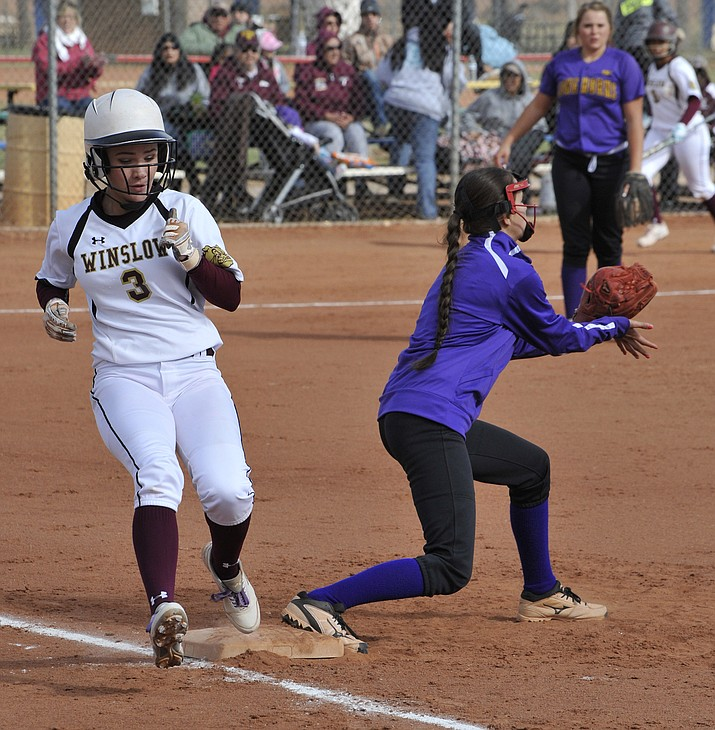 A Lady Bulldog beats the throw to first base. Todd Roth/NHO
