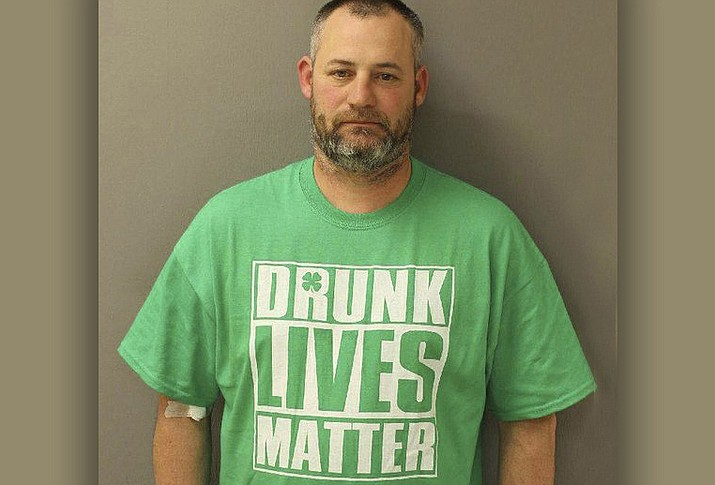 Police in Pennsylvania say they arrested Elwood Gutshall III wearing a 'Drunk Lives Matter' shirt for drunken driving. Police say the 44-year-old's blood-alcohol content was about two and a half times the state's legal limit for drivers when he was pulled over early on March 19, 2017 in Newville, Pa.