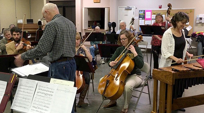 "Percussionist Maria Flurry, right, rehearses with the Prescott Chamber Orchestra as they practice ""Ragtime Dances,"" a world premiere, for the Exotic Spring concert Friday, April 7."
