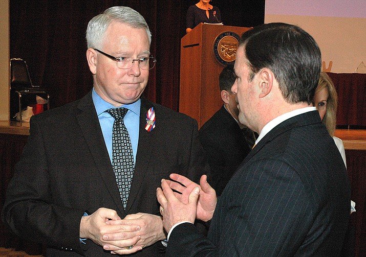 Maricopa County Attorney Bill Montgomery chats Tuesday with Gov. Doug Ducey at a luncheon. Montgomery said he will ask the governor to veto legislation changing the civil forfeiture laws if the bill remains in the form approved unanimously earlier this week by the state Senate. (Capitol Media Services photo by Howard Fischer)