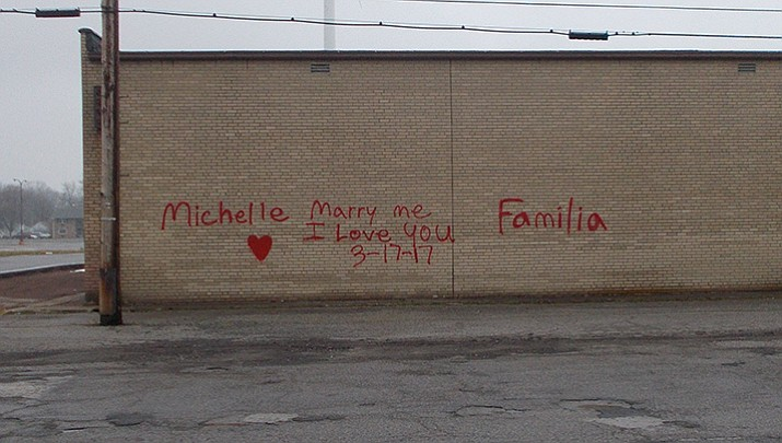 """According to police, 23-year-old Kyle Stump admitted to spray-painting the side of a shopping center with a heart and the words, """"Michelle Marry Me I Love You Familia 3-17-17"""""""