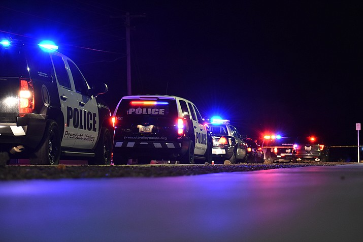 Police closed the roads at Loos Drive and Katie Circle West near Mountain Valley Park in Prescott Valley late Wednesday night, April 5, 2017 after a man opened fire on police officers conducting a trespassing investigation.