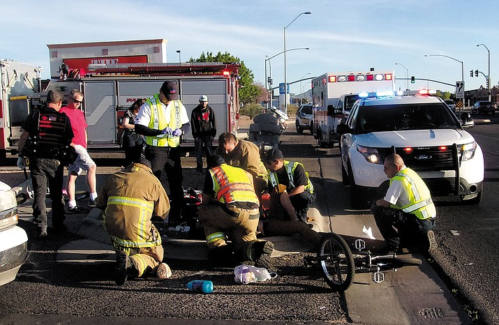 A bicyclist crashed into a pickup truck Wednesday. The rider suffered a fractured leg.
