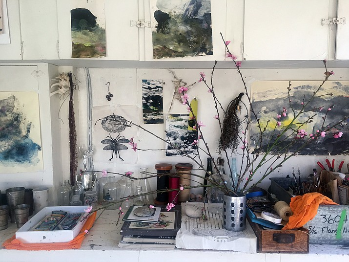 This March 7 photo provided by artist Louesa Roebuck shows her work studio in Ojai, Calif. Some of her monotype studies are seen. A few pieces by friends and creative growth artist also adorn the studio along with the peach blossoms.