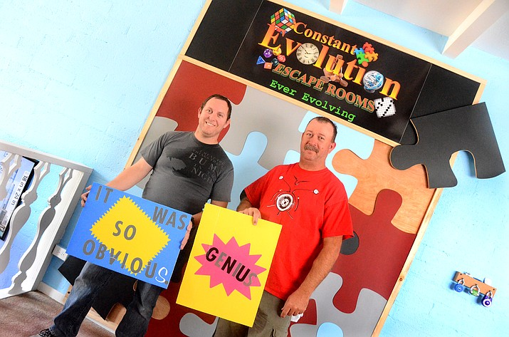 James Stevens, red shirt, and Shawn Lowman, owners of the Constant Evolution Escape Rooms in Cottonwood, pose for photos at their new Cottonwood business. VVN/Vyto Starinskas
