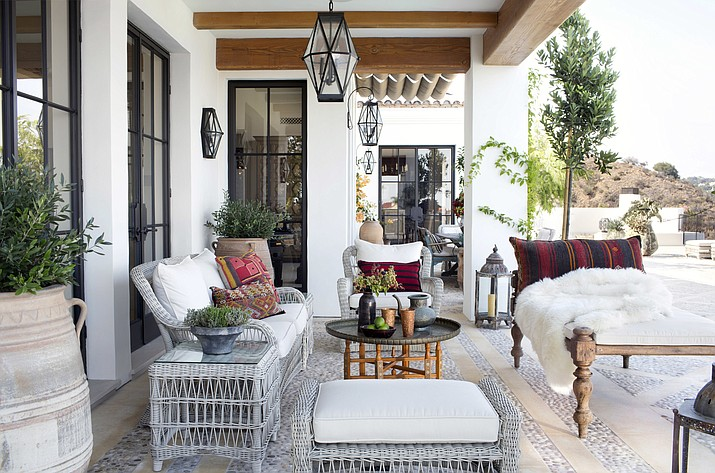 This undated photo provided by Betsy Burnham shows a patio area in Los Angeles designed by Burnham of Burnham Design. Rather than selecting a set of matching outdoor furnishings, designers are encouraging clients to mix and match a variety of styles and brands as they decorate their outdoor space. (Sarah Dorio/Betsy Burnham via AP)