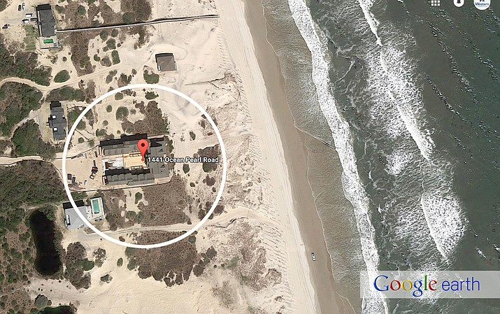 The owner of this $4.6 million property in North Carolina's Outer Banks is arguing in court that the house -- with enough beds to sleep 50 people -- is a single-family home.