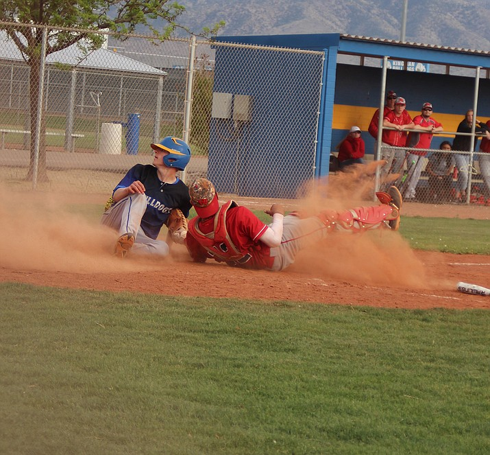 Kingman's Brennon Ogle scores the Bulldogs' first run of the game in the fourth inning Friday at KHS. Kingman took down River Valley in eight innings, 6-5.