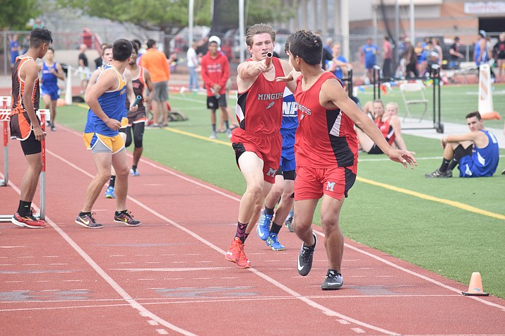 Mingus Union sophomore Cody Wager hands the baton off to senior Alberto Silvain in the 4x800 meter relay at the Mingus Invitational on Friday at home. (VVN/James Kelley)