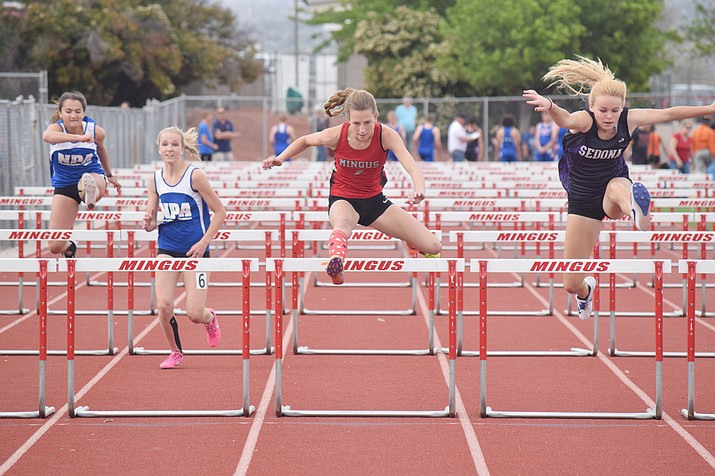 "Mingus Union junior Hannah DeVore (center) competes in the 100 meter hurdles at the Mingus Invitational on Friday at home. Head coach Yancey DeVore said his daughter is ""starting to get back into the groove"" after starting the season injured. (VVN/James Kelley)"