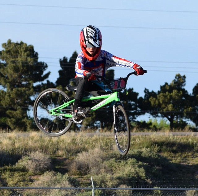 Josh White gets high in the air during High Desert 66 BMX racing Wednesday at the fairgrounds.