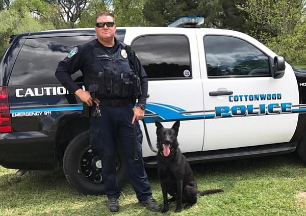 Cottonwood Police Department's new K9 officer, Kratos, poses with his handler, Officer Cory Shilling.