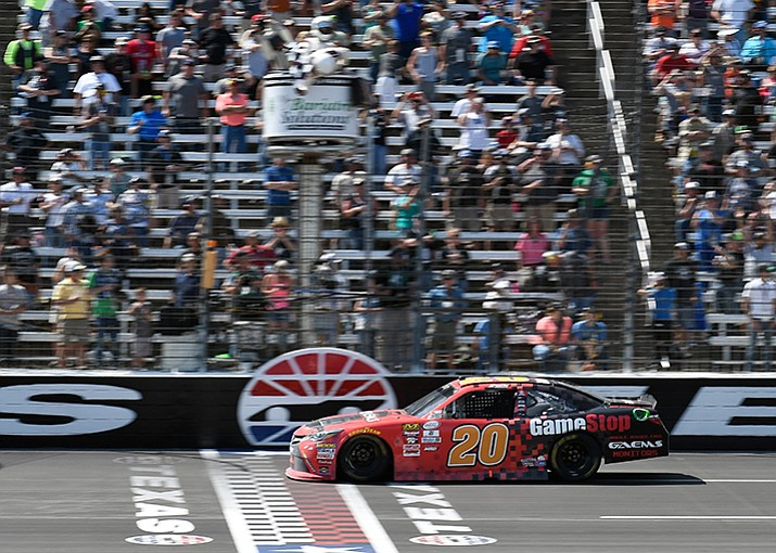 Erik Jones crosses the finish line for the win in the Xfinity Series auto race at Texas Motor Speedway in Fort Worth, Texas, Saturday, April 8.