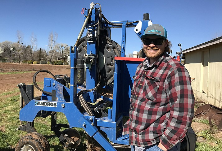 Zach Hauser is converting fields from flood to drip irrigation to conserve water for the Verde River. Hauser's new machinery helps move the drip lines to irrigate his vegetables. Photo: Sandra Postel