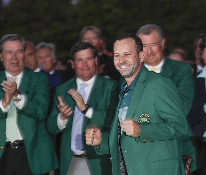 Sergio Garcia, of Spain, celebrates at the green jacket ceremony after the Masters golf tournament Sunday, April 9, 2017, in Augusta, Ga. An authentic green jacket from Augusta National Golf Club that was originally bought for $5 at a thrift store has sold at auction for more than $139,000.