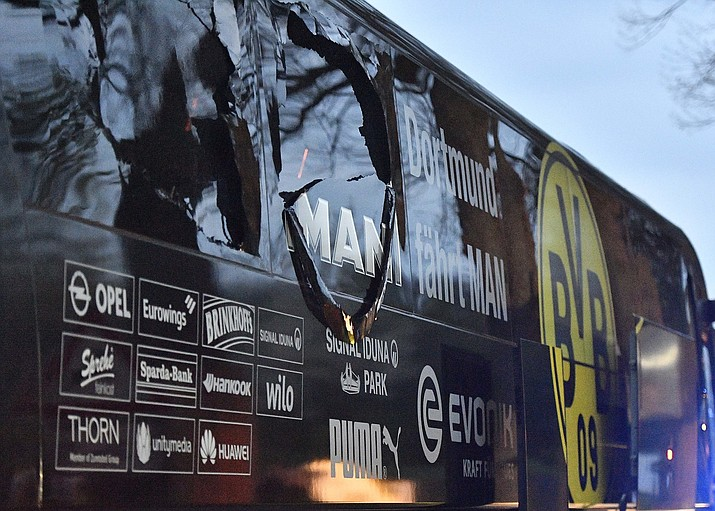 A window of Dortmund's team bus is damaged after an explosion before the Champions League quarterfinal soccer match Tuesday, April 11, between Borussia Dortmund and AS Monaco in Dortmund, western Germany. (Martin Meissner/AP)