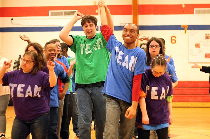 YouthAbility students bow to a round of applause from the audience after performing their original play at Grand Canyon School March 30.