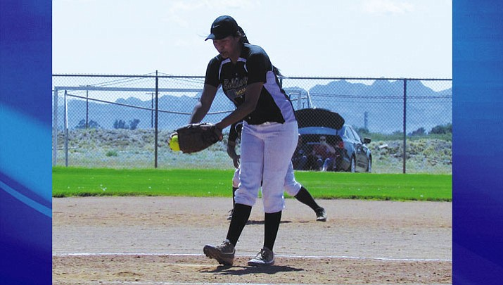 Kingman's Payton Chamberlain works on her two-hitter during the Lady Bulldogs' 12-1 win at Parker.