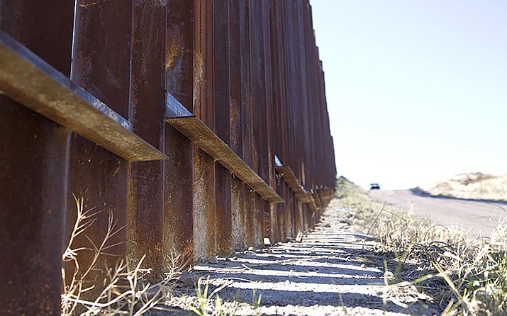 A stretch of U.S.-Mexico border wall near Nogales. A Trump administration plan to extend the wall the length of the southern border would run it through the middle of the Tohono O'odham Nation west of here, worrying tribal groups. Photo/Josh Orcutt, Cronkite News