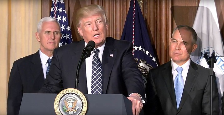 President Donald Trump, with Vice President Mike Pence, left, and Environmental Protection Agency Director Scott Pruitt, at the EPA, where Trump signed an executive order rolling back Obama coal and climate restrictions.